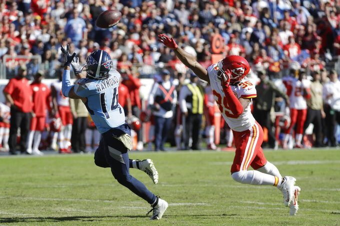 Tennessee Titans wide receiver Kalif Raymond (14) catches a pass ahead of Kansas City Chiefs cornerback Charvarius Ward (35) in the first half of an NFL football game Sunday, Nov. 10, 2019, in Nashville, Tenn. (AP Photo/James Kenney)