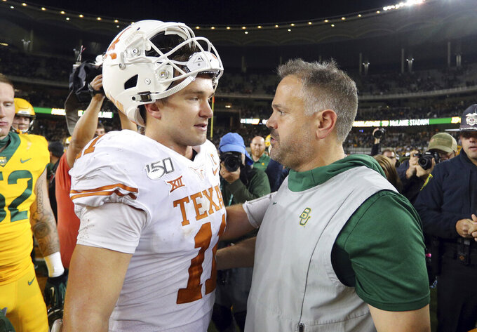 Texas quarterback Sam Ehlinger (11) meets Baylor head coach Matt Rhule on the field after an NCAA college football game Saturday, Nov. 23, 2019, in Waco, Texas. (AP Photo/Richard W. Rodriguez)