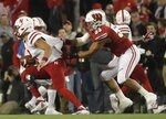 Wisconsin's T.J. Edwards sacks Nebraska's Adrian Martinez during the first half of an NCAA college football game Saturday, Oct. 6, 2018, in Madison, Wis. (AP Photo/Morry Gash)