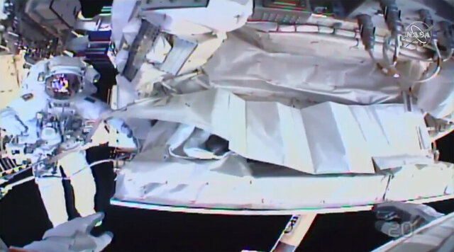 This photo provided by NASA shows the view from NASA's Andrew Morgan's helmet cam as Italian astronaut Luca Parmitano works outside the International Space Station during a spacewalk Saturday, Jan. 25, 2020.  The astronauts worked to complete repairs to a cosmic ray detector outside the International Space Station.   (NASA via AP)