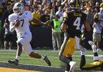 Colorado State quarterback Todd Centeio (7) runs for a touchdown during the first half of an NCAA college football game against Iowa, Saturday, Sept. 25, 2021, in Iowa City, Iowa. (AP Photo/Ron Johnson)