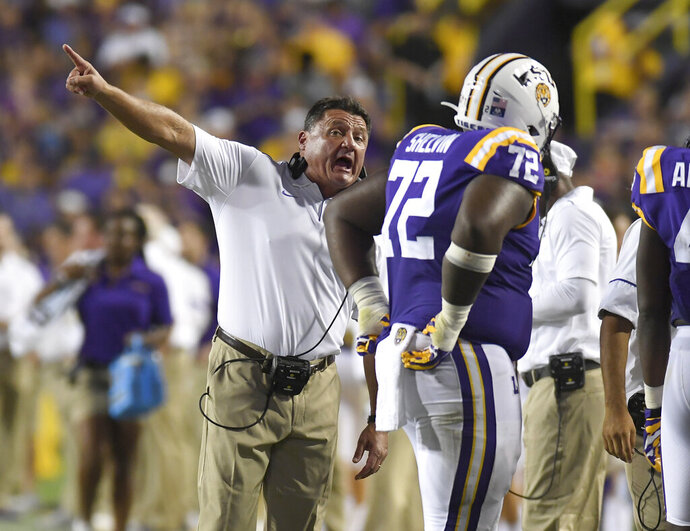 LSU head coach Ed Orgeron instructs nose tackle Tyler Shelvin (72) in the first half of an NCAA football game against Northwestern State Saturday in Baton Rouge, La., Sept. 14, 2019. (AP Photo/Patrick Dennis)