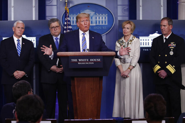 President Donald Trump takes questions from reporters as he speaks about the coronavirus in the James Brady Briefing Room, Monday, March 23, 2020, in Washington. Listens from left are Vice President Mike Pence, Attorney General William Barrm Dr. Deborah Birx, White House coronavirus response coordinator, and Navy Rear Adm. John Polowczyk, supply chain task force lead at FEMA, (AP Photo/Alex Brandon)