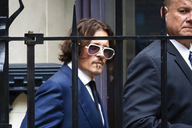 Actor Johnny Depp leaves the High Court in London, Tuesday, July 7, 2020.  The libel case by Depp against a British tabloid newspaper started Tuesday over a 2018 article that branded him violent and abusive to then-wife Amber Heard. Depp strongly denies the claim. (Aaron Chown/PA via AP)