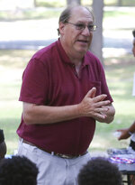 Harry Shur speaks to his campers and guests at a reception and awards ceremony during the Tennis Rocks Tutoring and Music Association's last day of its summer session for young people at Haynes Park Thursday, Aug. 5, 2021, in Wilmington, Del. (William Bretzger/The News Journal via AP)