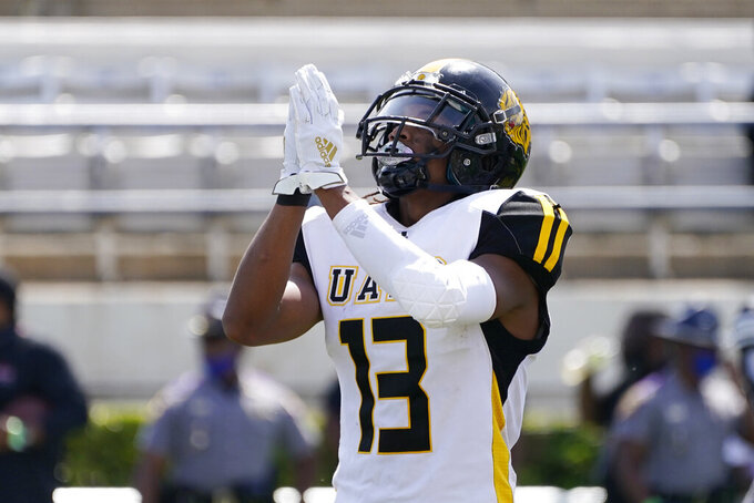 Arkansas-Pine Bluff wide receiver DeJuan Miller (13) celebrates his touchdown reception past an Alabama A&M defender during the first half of the Southwestern Athletic Conference NCAA college football game, Saturday, May 1, 2021, in Jackson, Miss. (AP Photo/Rogelio V. Solis)