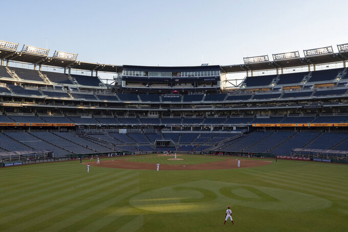 The stands are empty during an exhibition baseball game between the Washington Nationals and the Philadelphia Phillies at Nationals Park, Saturday, July 18, 2020, in Washington. (AP Photo/Alex Brandon)