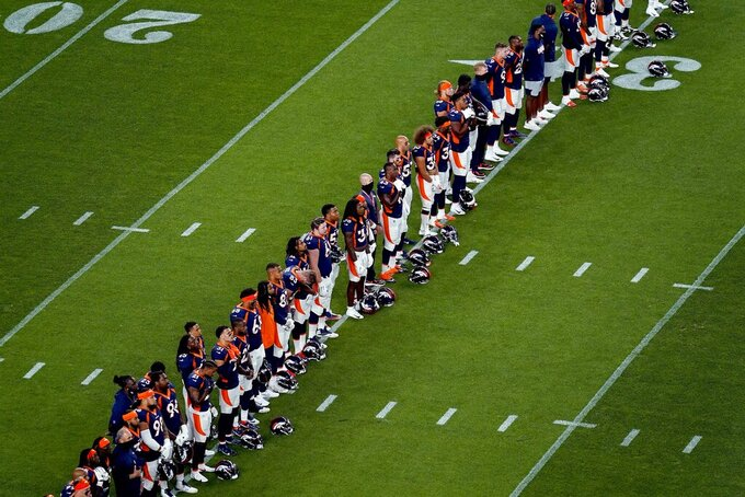 "The Denver Broncos stand during a rendition of ""Lift Every Voice and Sing"" prior to an NFL football game against the Tennessee Titans, Monday, Sept. 14, 2020, in Denver. (AP Photo/Jack Dempsey)"