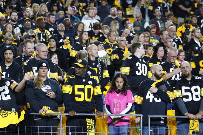 Fans at Heinz Field stand for moment of silence in memory of the attack on the Tree of Life Synagogue a year ago on Oct. 27, 2018, before an NFL football game between the Pittsburgh Steelers and the Miami Dolphins in Pittsburgh, Monday, Oct. 28, 2019. (AP Photo/Keith Srakocic)