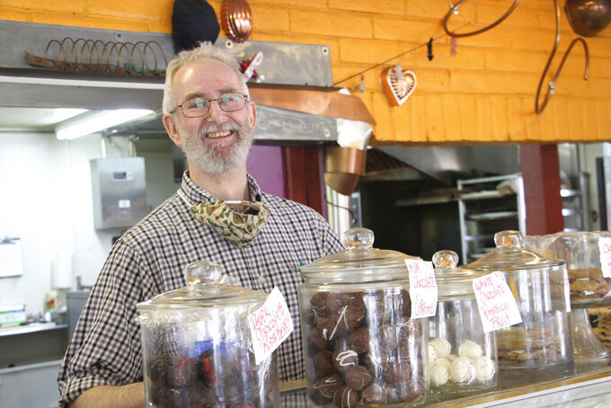 Simon Newall, the co-owner of Sweet Basil Cafe in Anchorage, Alaska, poses for a photo Monday, April 27, 2020. The first signs of activity returned to Alaska's largest city Monday as businesses like hair salons and restaurants slowly began reopening following closures because of the coronavirus. (AP PhotoMark Thiessen)
