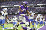 Minnesota Vikings running back Dalvin Cook (33) scores on a 3-yard touchdown run during the first half of an NFL football game against the Detroit Lions, Sunday, Dec. 8, 2019, in Minneapolis. (AP Photo/Andy Clayton-King)