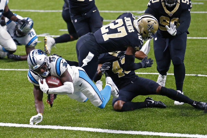 Carolina Panthers wide receiver Curtis Samuel (10) crosses the goal line in front of New Orleans Saints strong safety Malcolm Jenkins (27) and free safety Marcus Williams (43) on a touchdown carry in the second half of an NFL football game in New Orleans, Sunday, Oct. 25, 2020. (AP Photo/Brett Duke)