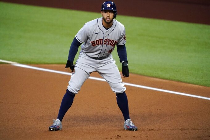 FILE - In this Sept. 25, 2020, file photo, Houston Astros' George Springer takes a lead off first during the first inning of the team's baseball game against the Texas Rangers in Arlington, Texas. Springer became the most prominent among baseball's free agents to reach an agreement, a $150 million, six-year contract with the Toronto Blue Jays, a person familiar with the negotiations told The Associated Press. The person spoke on condition of anonymity Tuesday night, Jan. 19, 20201, because the deal was subject to a successful physical. (AP Photo/Tony Gutierrez, File)