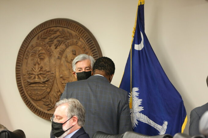 South Carolina Sen. Nikki Setzler, D-West Columbia, talks to Sen. Darrell Jackson, D-Hopkins, right, after a Senate Finance Committee meeting on Tuesday, April 20, 2021, in Columbia, S.C. The Senate Finance Committee approved its version of the state's roughly $10 billion spending plan for the next fiscal year. (AP Photo/Jeffrey Collins)