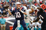 New England Patriots quarterback Mac Jones (10) looks to pass during the first half of an NFL football game against the Miami Dolphins, Sunday, Sept. 12, 2021, in Foxborough, Mass. (AP Photo/Winslow Townson)