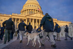 Federal K-9 units prepare for a security sweep in preparation for the inauguration ceremonies on Capitol Hill in Washington, Tuesday, Jan. 19, 2021. President-elect Joe Biden will be sworn in as the 46th president on Wednesday. (AP Photo/J. Scott Applewhite)
