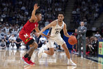 FILE - Penn State guard Myreon Jones (0) drives past Maryland guard Anthony Cowan Jr. (1) during the second half of an NCAA college basketball game in State College, Pa., in this Tuesday, Dec. 10, 2019, file photo. Penn State went 21-10, made a cameo appearance in the Top 25 for the first time since 1996 and finished 11-9 mark in conference play last season but lost leading scorer Lamar Stevens and leading rebounder Mike Watkins to graduation. The team that relied heavily on its frontcourt will have to find scoring from a backcourt led by junior Myreon Jones and Binghampton transfer Sam Sessoms. (AP Photo/Barry Reeger, File)