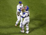 New York Mets relief pitcher Edwin Diaz, left, celebrates with catcher Tomas Nido after the team's baseball game against the Miami Marlins on Saturday, May 11, 2019, in New York. The Mets won 4-1. (AP Photo/Frank Franklin II)