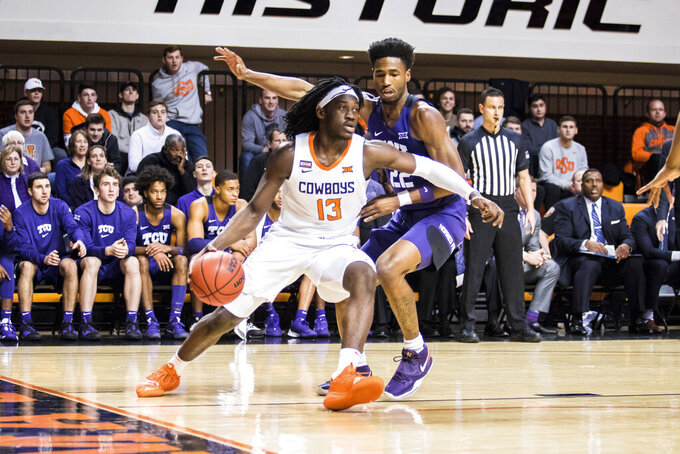 Oklahoma State guard Issac Likekele drives against TCU's RJ Nembhard during an NCAA college basketball game Wednesday, Feb. 5, 2020, in Stillwater, Okla. (Devin Lawrence/Tulsa World via AP)
