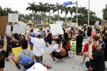 People protest over the death of George Floyd outside of the Trump National Doral, Saturday, June 6, 2020, in Doral, Fla. Protests continue over the death of Floyd, a black man who died after he was restrained while in police custody May 25 in Minneapolis. (AP Photo/Lynne Sladky)