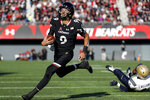 Cincinnati quarterback Desmond Ridder (9) runs in for a touchdown in the first half of an NCAA college football game against Navy, Saturday, Nov. 3, 2018, in Cincinnati. (AP Photo/John Minchillo)
