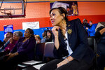 Flint Mayor Karen Weaver listens on as during a presentation and announcement by tech billionaire Elon Musk on Friday, March 22, 2019 at Doyle-Ryder Elementary School in Flint. Musk is providing a Chromebooks for every seventh-grader in the 2019-20 school year and will provide water filtration systems to be installed in all Flint schools. (Jake May/The Flint Journal via AP)