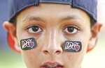 Chris Howell, 11, shows off some 1ooth year stickers on Sunday during a