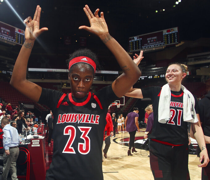 Louisville guard Jazmine Jones (23) and forward Kylee Shook (21) celebrate after an NCAA college basketball game against Florida State in Tallahassee, Fla., Thursday, Jan. 24, 2019. (AP Photo/Phil Sears)