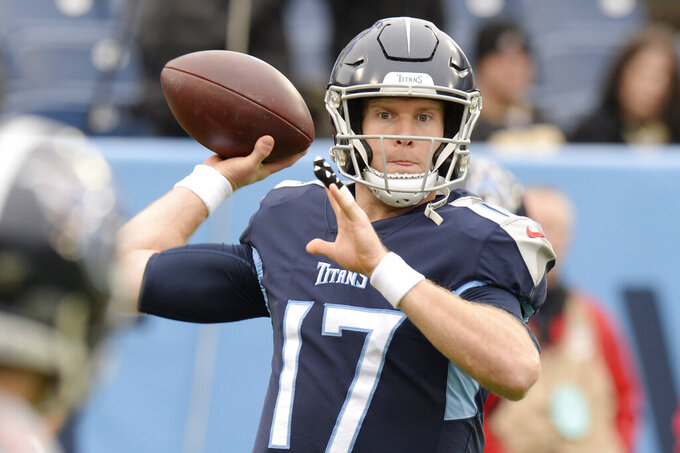 Tennessee Titans quarterback Ryan Tannehill warms up before an NFL football game against the New Orleans Saints Sunday, Dec. 22, 2019, in Nashville, Tenn. (AP Photo/Mark Zaleski)