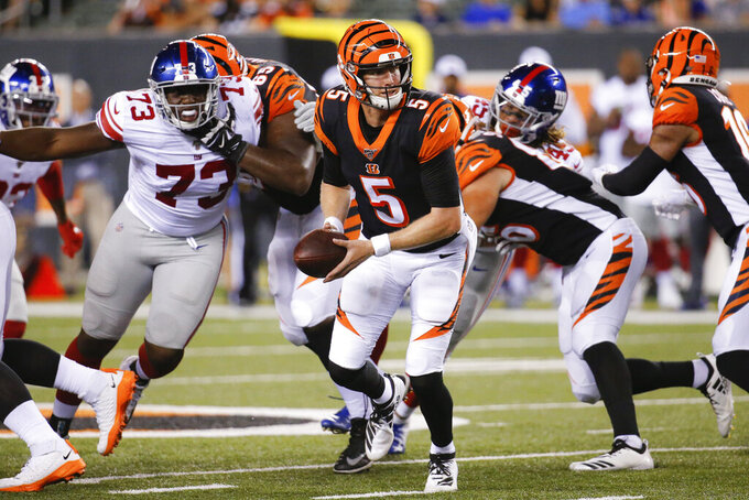 Cincinnati Bengals quarterback Ryan Finley (5) looks to hand off the ball during the second half of the team's NFL preseason football game against the New York Giants, Thursday, Aug. 22, 2019, in Cincinnati. (AP Photo/Frank Victores)
