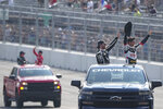 Conor Daly and Rinus VeeKay circle the track before the IndyCar Music City Grand Prix auto race Sunday, Aug. 8, 2021, in Nashville, Tenn. (AP Photo/Harrison McClary)
