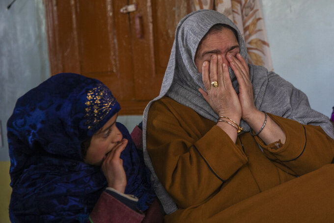 """Dilshada Banoo, aunt of 16-year-old Athar Mushtaq, breaks down while talking to Associated Press in Bellow, south of Srinagar, Indian controlled Kashmir, Tuesday, Jan. 5, 2021. On the last week of 2020, Indian government forces killed Athar and two other young men during a controversial gunfight on the outskirts of the Indian-controlled Kashmir's main city. Police did not call them anti-India militants but """"hardcore associates of terrorists."""" They later buried them at a graveyard in a remote mountainous tourist resort miles away from their ancestral villages. Athar was the latest Kashmiri to be buried in a far-off graveyard after Indian authorities in a new controversial policy in 2020 started to consign blood-soaked bodies of scores of Kashmiri suspected rebels to unmarked graves, denying the mourning families a proper funeral and a burial. (AP Photo/ Dar Yasin)"""