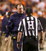 Virginia coach Bronco Mendenhall talks with an official during the first half of the team's NCAA college football game against William & Mary in Charlottesville, Va., Friday, Sept. 6, 2019. (AP Photo/Andrew Shurtleff)