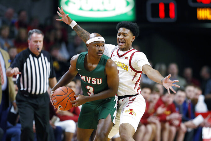 Mississippi Valley State guard Caleb Hunter, left, looks to pass around Iowa State guard Prentiss Nixon during the first half of an NCAA college basketball game, Tuesday, Nov. 5, 2019, in Ames, Iowa. (AP Photo/Charlie Neibergall)
