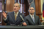 FILE - In this June 21, 2019 file photo, Gov. Greg Abbott, left, speaks at a news conference at the Capitol, in Austin, Texas. Abbott says the state will reject the re-settlement of new refugees, becoming the first state known to do so under a recent Trump administration order. In a letter released Friday, Jan, 10, 2020, Abbott wrote that Texas