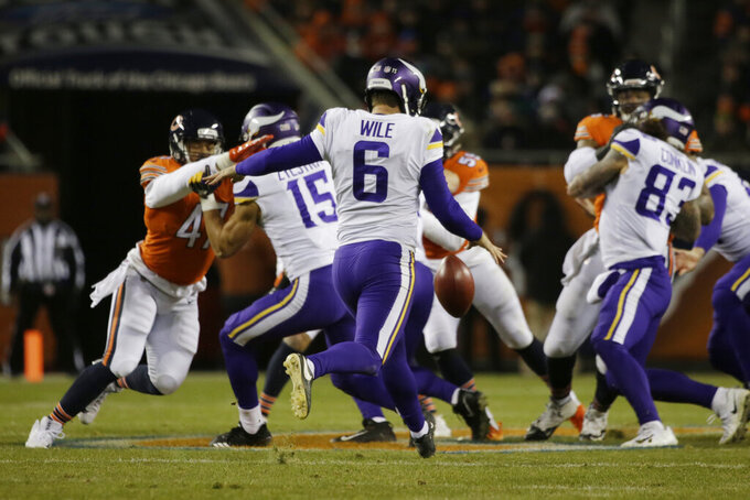"FILE - In this Nov. 18, 2018, file photo, Minnesota Vikings' Matt Wile (6) punts during the second half of an NFL football game against the Chicago Bears in Chicago. Coach Mike Zimmer said he was ""at a loss"" about his specialists, after Kaare Vedvik missed two field goals in the last exhibition game. With four days left before roster reduction day, the Vikings still don't have clarity about whether kicker Dan Bailey and punter Matt Wile will stay or if Vedvik will replace one of them. (AP Photo/David Banks, File)"