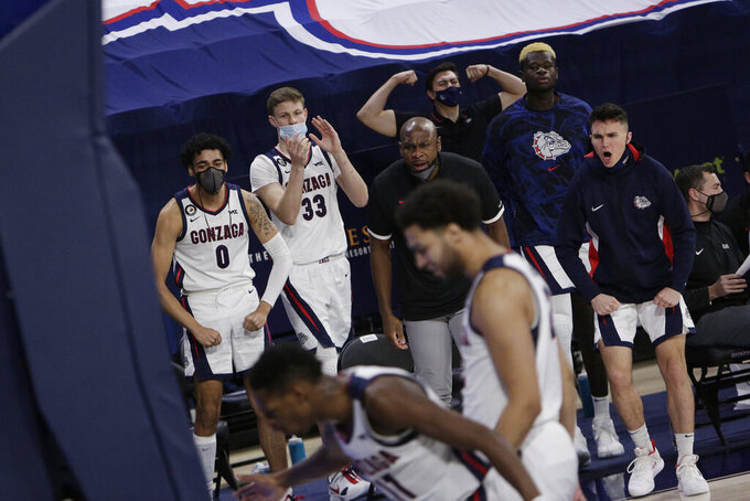 The Gonzaga bench celebrates during the second half of an NCAA college basketball game against Santa Clara in Spokane, Wash., Thursday, Feb. 25, 2021. (AP Photo/Young Kwak)