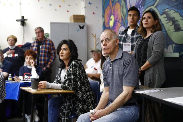 Caucus-goers listen to a precinct leader at a caucus location at Coronado High School in Henderson, Nev., Saturday, Feb. 22, 2020. (AP Photo/Patrick Semansky)