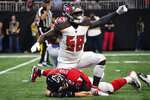 Tampa Bay Buccaneers linebacker Shaquil Barrett (58) celebrates his sack on Atlanta Falcons quarterback Matt Ryan during the first half of an NFL football game, Sunday, Nov. 24, 2019, in Atlanta. (AP Photo/John Amis)