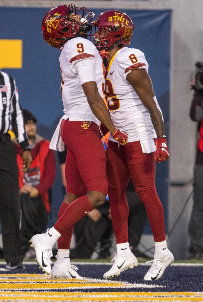 Iowa State wide receivers Joseph Scates (9) and Deshaunte Jones (8) celebrate a touchdown during the second half of an NCAA college football game against West Virginia, Saturday, Oct. 12, 2019, in Morgantown, W.Va. (AP Photo/Raymond Thompson)