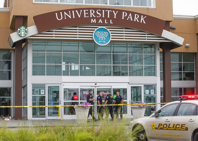 Police respond to University Park Mall following a shooting on Saturday, Sept. 12, 2020, in Mishawaka, Ind. A shooting at the northern Indiana mall left one person dead and sent shoppers running for safety, authorities said. St. Joseph County Coroner Michael McGann said Saturday evening that one person was killed in the shooting about 3 p.m. at the mall. (Robert Franklin/South Bend Tribune via AP)