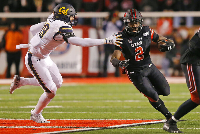 Utah running back Zack Moss (2) outruns California linebacker Cameron Goode (19) in the first half of an NCAA college football game Saturday, Oct. 26, 2019, in Salt Lake City. (AP Photo/Rick Bowmer)