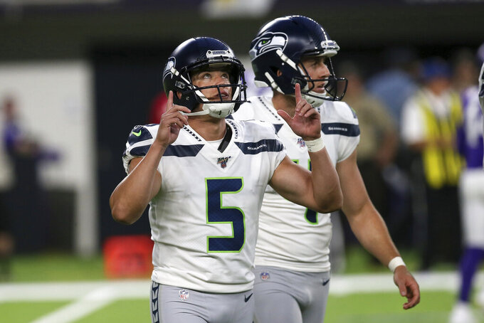Seattle Seahawks kicker Jason Myers (5) celebrates after making a 33-yard field goal during the first half of an NFL preseason football game against the Minnesota Vikings, Sunday, Aug. 18, 2019, in Minneapolis. (AP Photo/Jim Mone)