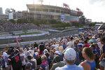 Fans watch the IndyCar Music City Grand Prix auto race Sunday, Aug. 8, 2021, in Nashville, Tenn. (AP Photo/Harrison McClary)