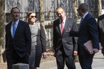 Former U.S. Rep. Chris Collins, second from right, arrives at Federal court, Tuesday, Oct. 1, 2019, in New York. Collins is expected to plead guilty in an insider trading case Tuesday, a day after saying he was quitting Congress. (AP Photo/Mary Altaffer)