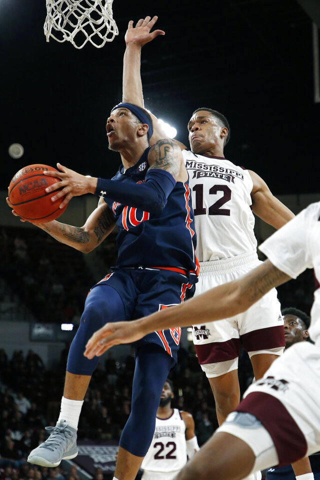 Auburn guard Samir Doughty (10) attempts a layup past Mississippi State guard Robert Woodard II (12) during the second half of an NCAA college basketball game, Saturday, Jan. 4, 2020, in Starkville, Miss. Auburn won 80-68. (AP Photo/Rogelio V. Solis)