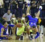 Baylor guard King McClure (3) comes up with a loose ball against Kansas guard Quentin Grimes (5), left, as Kansas forward Mitch Lightfoot (44) trips over Baylor guard Mark Vital (11) in the first half of an NCAA college basketball game, Saturday, Jan. 12, 2019, in Waco, Texas. (AP Photo/Jerry Larson)
