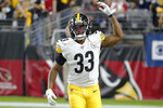 FILE - In this Dec. 8, 2019, file photo, Pittsburgh Steelers running back Trey Edmunds (33) gestures during an NFL football game against the Arizona Cardinals, in Glendale, Ariz.  Ferrell and Felicia Edmunds can't lose. Nor can they be prouder when the Pittsburgh Steelers host the Buffalo Bills on Sunday night Dec. 15. It's a game that will feature all three of the Edmunds' sons _ the Steelers' Terrell and Trey Edmunds and the Bills' Tremaine _ facing off against each other. (AP Photo/Rick Scuteri, File)
