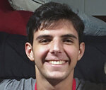 "This August 2019 photo provided by Dave Goren shows Max Goren smiling on move in day at North Carolina State University in Raleigh, N.C. A student from N.C. State University has kept alive a tradition associated with postseason college basketball. Max Goren produced his own version of ""One Shining Moment,"" similar to the video which CBS Sports showcases at the end of the men's national championship game. Goren's work became something of a sensation, drawing nearly 63,000 views as of Monday, and requests to simulate his work for other sports. (Dave Goren via AP)"