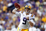 FILE - In this Aug. 31, 2019, file photo, LSU quarterback Joe Burrows (9) throws a pass during the NCAA football team's game against Georgia Southern in Baton Rouge, La. LSU faces Texas this week. Burrow has accounted for 15 touchdowns in LSU's last three games, including a school record-tying five TDs passes in the season opener, and is the first Tigers quarterback ever with 20 completions in four consecutive games. (AP Photo/Tyler Kaufman, File)